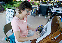 NWA Democrat-Gazette/DAVID GOTTSCHALK   Amy Edie, of Fayetteville, works on an animal portrait from a digital image using part graphite and conte-cryon Thursday, August 13, 2015 at the Fayetteville Farmers' Market. Edie draws portraits of people and animals from live subjects and photographs at the market that is open Tuesday and Thursday from 7:00 a.m. to 1:00 p.m. and on Saturday from 7:00 a.m. to 2:00 p.m.