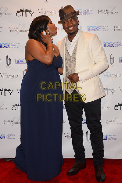 02 March 2014 - Beverly Hills, California - Brely Evans, Ne-Yo.  Fame and Philanthropy Post-Oscar Gala celebrating the 86th Annual Academy Awards held at The Vineyard Beverly Hills. <br /> CAP/ADM/BT<br /> &copy;Birdie Thompson/AdMedia/Capital Pictures
