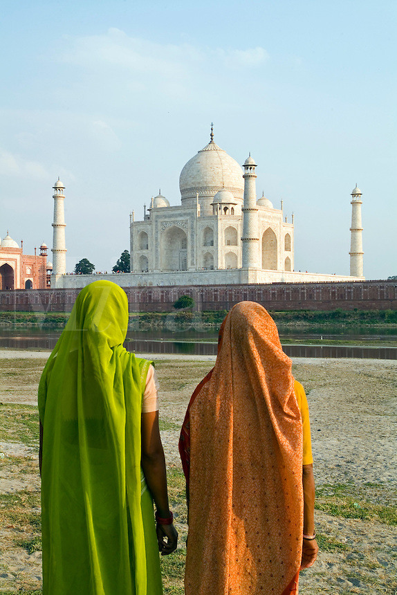 Taj Mahal temple burial site with Indian women in sari, Yamuna River, Agra, India