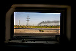 A war-ravaged Iraqi landscape as seen from the window of a passing U.S. Army Humvee, July 28, 2007