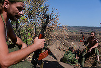 Pro-Russian rebels chat, while guarding their positions near Luhansk, Eastern Ukraine. August 15, 2014