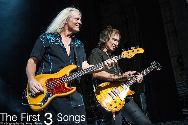 Dave Amato and Bruce Hall of REO Speedwagon perform at Riverbend Music Center in Cincinnati, Ohio.