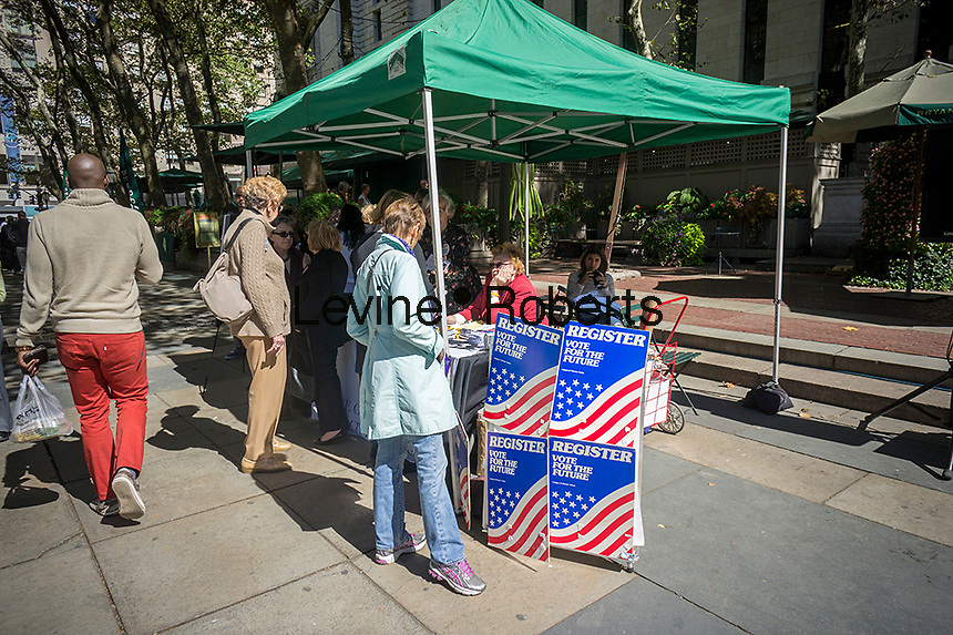 Members of the League of Women Voters celebrate National Voter Registration Day in Bryant Park in New York on Tuesday, September 24, 2013. Tables were set up and numerous groups enticed the non-registered to register to vote. (© Richard B. Levine)