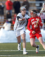Boston University midfielder Sydney Godett (20) on the attack as Boston College midfielder Mikaela Rix (17) defends..Boston College (white) defeated Boston University (red), 12-9, on the Newton Campus Lacrosse Field at Boston College, on March 20, 2013.