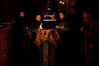 Mount Athos - The Holy Mountain.<br /> Monks chant a prayer at a midnight service.<br /> Photographer: Rick Findler