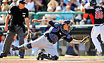 8 March 2011: New York Yankees' catcher Jesus Montero is unable to tag Dan Uggla out at the plate during a Spring Training game against the Atlanta Braves at Champion Park in Orlando, Florida. The Yankees edged out the Braves 5-4 in Grapefruit League action. Mandatory Credit: Ed Wolfstein Photo