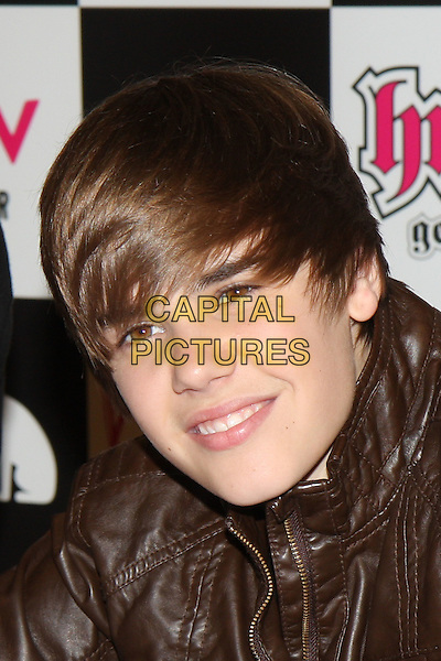JUSTIN BIEBER.Justin Bieber meets fans & signs copies of his debut album 'My World' at HMV Westfield Shopping Centre, London, England..January 18th, 2010 .headshot portrait brown leather .CAP/MAR.©Martin Harris/Capital Pictures