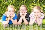 Chloe Barrett, Aoife Falvey and Lucy Ashe Annuscaul NS relaxing at the Kerry Primary School Sports County Finals in An Riocht Castleisland