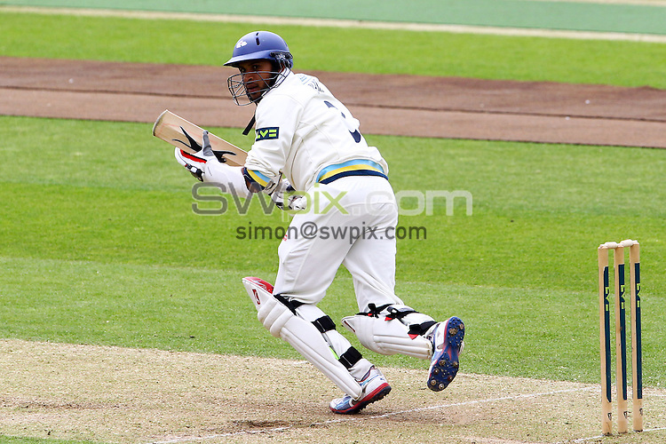 PICTURE BY ALEX WHITEHEAD/SWPIX.COM - Cricket - County Championship - Yorkshire v Somerset, Day 2 - Headingley, Leeds, England - 08/05/13 - Yorkshire's Adil Rashid hits out.