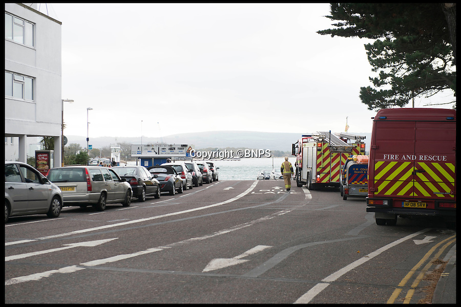 BNPS.co.uk (01202 558833)<br /> Pic: LauraDale/BNPS<br /> <br /> Traffic and emergency services of the ferry slipway.<br /> <br /> An elderly woman has today been rescued from her sunken car after she 'deliberately' drove into a harbour in front of stunned 