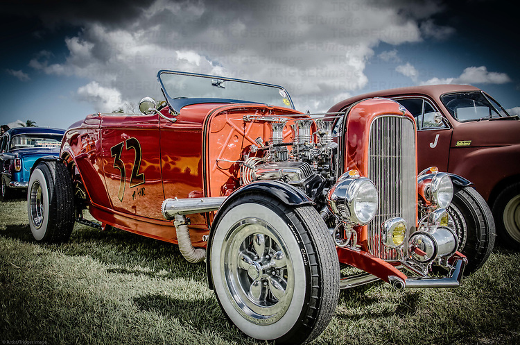 Classic American muscle car in red with chrome grill