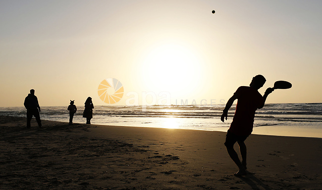 Palestinians play tennis along the along the Mediterranean coast at the beach of Gaza city, February 11, 2019. Photo by Mahmoud Naser