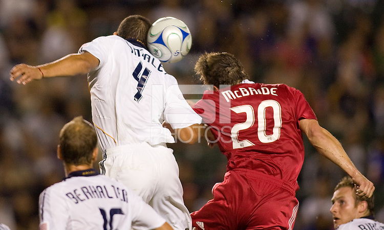 LA Galaxy rookie defender Omar Gonzalez and Chicago Fire veteran forward Brian McBride battle. The LA Galaxy defeated the Chicago Fire 1-0 at Home Depot Center stadium in Carson, California on Friday October 2, 2009...