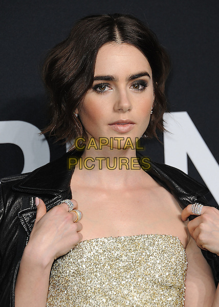 HOLLYWOOD, CA - FEBRUARY 10:  Lily Collins at Saint Laurent at The Palladium at the Hollywood Palladium on February 10, 2016 in Hollywood, California. <br /> CAP/MPI/PGSK<br /> &copy;PGSK/MPI/Capital Pictures