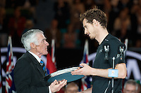 January 31, 2016: Andy Murray of United Kingdom accepts the Men's Final runners up trophy from Ken Rosewall on day fourteen of the 2016 Australian Open Grand Slam tennis tournament at Melbourne Park in Melbourne, Australia. Novak Djokovic won 61 75 76. Photo Sydney Low