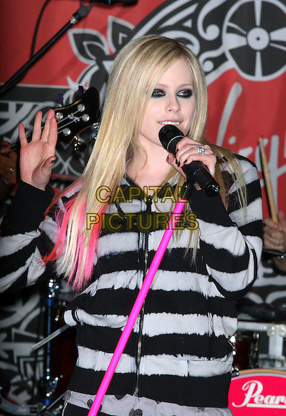 AVRIL LAVIGNE.At her In-Store Performance at Virgin Megastore, New York, NY, USA..April 18th, 2007.half length black grey gray top pink hair streaks eyeliner makeup make up make-up live in concert gig performance singing microphone nail varnish polish hand.CAP/IW.©Ian Wilson/Capital Pictures