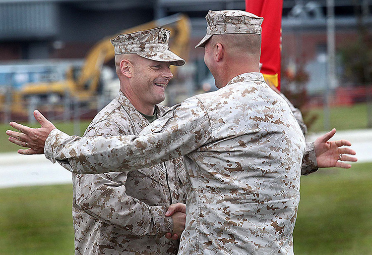 Col. Archibald M. McLellan (left) and Col. Jeffrey W. Fultz congratulate each other during Thursday's MARSOC Change of Command ceremony at Stone's Bay, Camp Lejeune. Col. Jeffrey Fultz relinquished command MARSOC to Col. Archibald M. McLellan.