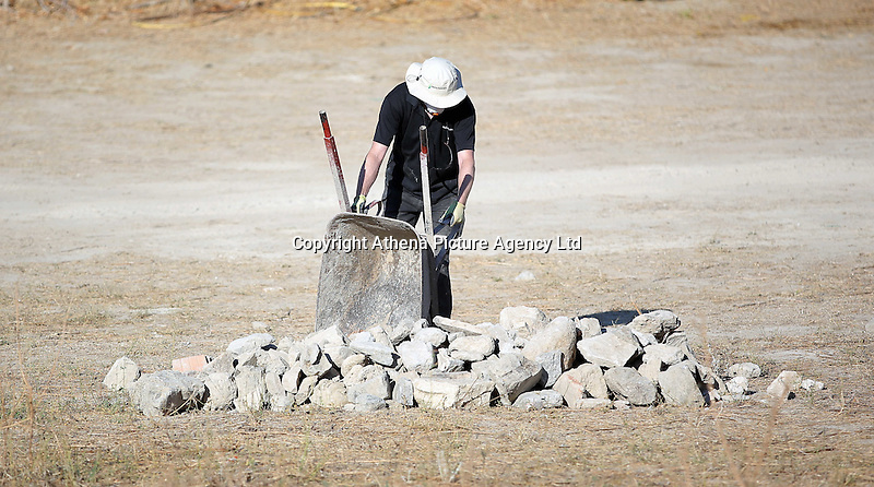 Pictured: An offcer unloads rubble from the site where the farmhouse extension used to be in Kos, Greece. Thursday 06 October 2016<br />Re: Police teams led by South Yorkshire Police, searching for missing toddler Ben Needham on the Greek island of Kos have moved to a new area in the field they are searching.<br />Ben, from Sheffield, was 21 months old when he disappeared on 24 July 1991 during a family holiday.<br />Digging has begun at a new site after a fresh line of inquiry suggested he could have been crushed by a digger.