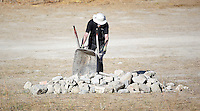 Pictured: An offcer unloads rubble from the site where the farmhouse extension used to be in Kos, Greece. Thursday 06 October 2016<br />