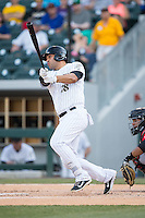 Matt Tuiasosopo (18) of the Charlotte Knights follows through on his swing against the Indianapolis Indians at BB&T BallPark on June 20, 2015 in Charlotte, North Carolina.  The Knights defeated the Indians 6-5 in 12 innings.  (Brian Westerholt/Four Seam Images)