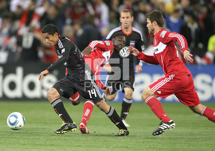 Andy Najar #14 of D.C. United breaks away from Patrick Nyarko #14 and Peter Lowry #8 of the Chicago Fire during an MLS match on April 17 2010, at RFK Stadium in Washington D.C. Fire won the match 2-0.