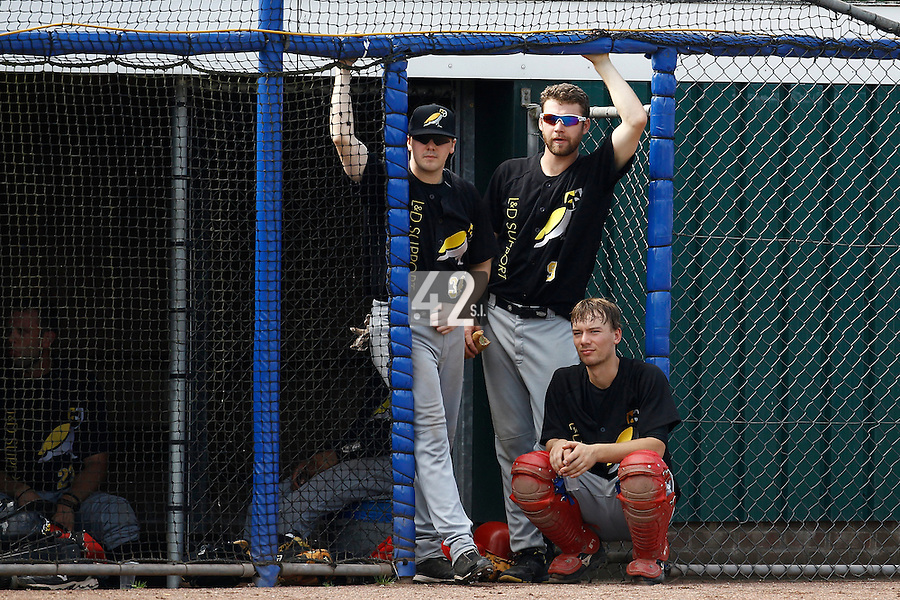 03 September 2011: Seb Visser, Ben Grover and Jelmer Witteveen of L&D Amsterdam Pirates are seen in the dugout during game 1 of the 2011 Holland Series won 5-4 in inning number 14 by L&D Amsterdam Pirates over Vaessen Pioniers, in Hoofddorp, Netherlands.
