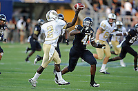 17 September 2011:  FIU linebacker Kenneth Dillard (41) puts pressure on UCF quarterback Jeff Godfrey (2) in the second quarter as the FIU Golden Panthers defeated the University of Central Florida Golden Knights, 17-10, at FIU Stadium in Miami, Florida.