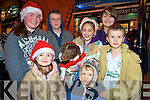 Erin Holland, Cathal Mackey, Sinead Moriarty, Saoirse Holland, Conor Kearney, Michael Kearney and Kerry Holland with Ruby the dog, at the switching on of the Christmas lights in Killarney on Friday night.
