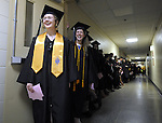 All smiles as Renee Ewing of Enfield, foreground,  and Toni Fedora of Suffield, are excited to start the march, during the Asnuntuck Community College graduation ceremony, Friday, May 31, 2013, at the the school in Enfield.  (Jim Michaud / Journal Inquirer)