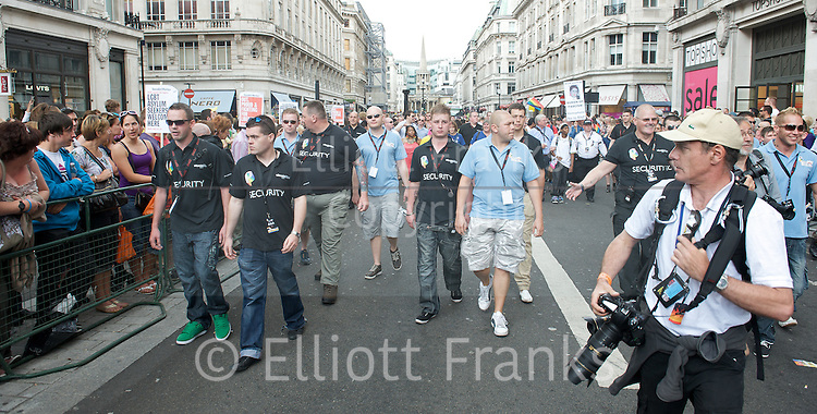 LGBT Pride Parade <br /> in Central London, Great Britain <br /> 2nd July 2011 <br /> <br /> Pride 2011 <br /> <br /> colour and atmosphere, floats, audience, people marching, and entertainment in Trafalgar Square. <br /> <br /> <br /> security trying to prevent the photographers from taking photos at the front of the march<br /> <br /> <br /> Photograph by Elliott Franks