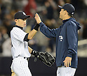 (L-R) Ichiro Suzuki, Hiroki Kuroda (Yankees),.APRIL 26, 2013 - MLB :.Ichiro Suzuki of the New York Yankees high-fives teammate Hiroki Kuroda during the baseball game against the Toronto Blue Jays at Yankee Stadium in The Bronx, New York, United States. (Photo by AFLO)
