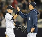 (L-R) Ichiro Suzuki, Hiroki Kuroda (Yankees),.APRIL 26, 2013 - MLB :.Ichiro Suzuki of the New York Yankees high-fives teammate Hiroki Kuroda during the baseball game against the Toronto Blue Jays at Yankee Stadium in The Bronx, New York, United States. (Photo by AFLO)