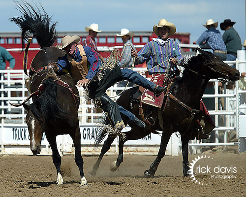 Craig Wisehart scores a 75 point bareback bronc ride on a Southwick Rodeo Company Bronc to win the Southeast Weld County CPRA Rodeo on August 12, 2006 in Keenesburg, Colorado. Craig hung in his rigging after the ride, but managed to keep his feet and was freed with the assistance of the pick up men, bullfighters and gatemen.