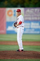 Auburn Doubledays relief pitcher David Smith (21) gets ready to deliver a pitch during a game against the Batavia Muckdogs on June 15, 2018 at Falcon Park in Auburn, New York.  Auburn defeated Batavia 5-1.  (Mike Janes/Four Seam Images)