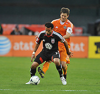 Dwayne De Rosario (7) of D.C. United shields the ball from Bobby Boswell (32) of the Houston Dynamo. The Houston Dynamo defeated D.C. United 4-0, at RFK Stadium, Wednesday May 8 , 2013.