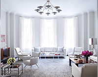 modern, contemporary, living room, colour, grey, wall covering, panelling, coving, fireplace, mantelpiece, seating, upholstered, sofa, armchair, leather, table, coffee table, storage, cabinet, sideboard, lighting, lamp, table lamp, ceiling light, pendant light, metal, soft furnishing, rug, cushion, curtain, floor-to-ceiling, window, bay window, texture, designer, Paul McCobb, Carlo di Carli, Batistin Spade, objects, artwork, modern art, spacious, retro, vintage, luxury, luxurious,