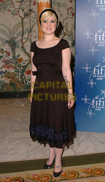 KELLY OSBOURNE.UK FiFi Awards 2006 Dorchester Hotel, London, UK..March 27th, 2006 .Ref: CAN.full length black dress belt tattoos blue detail trim alice band.www.capitalpictures.com.sales@capitalpictures.com.©Capital Pictures
