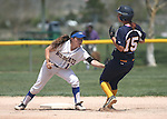 Western Nevada College's Katilyn Covione tags out the College of Southern Nevada's Rhiana Balaun on a baserunning error on Friday, May 2, 2014, in Carson City, Nev.<br /> Photo by Cathleen Allison/Nevada Photo Source