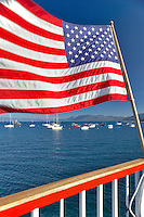 American flag on back of boat at Lake Tahoe. California