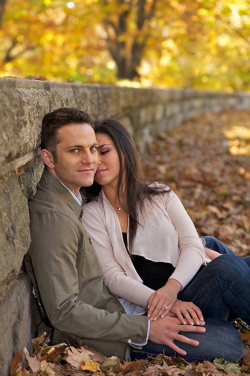 Engaged portrait of couple with fall foliage.