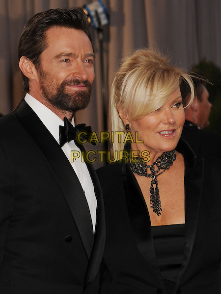 Hugh Jackman, Deborra-Lee Furness.85th Annual Academy Awards held at the Dolby Theatre at Hollywood & Highland Center, Hollywood, California, USA..February 24th, 2013.oscars half length black white shirt married husband wife tuxedo blazer necklace beard facial hair headshot portrait .CAP/ROT/TM.©Tony Michaels/Roth Stock/Capital Pictures