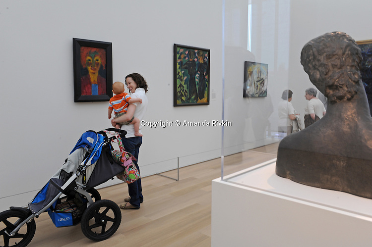"""A woman with her child looks at paintings in the recently unveiled Modern Wing of the Art Institute Chicago, designed by architect Renzo Piano on the first """"free Tuesday"""" where admission costs nothing and is open to the public, in Chicago, Illinois on May 19, 2009."""