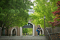 Students walk to and from class down the Bostock Library steps on a beautiful Spring morning.