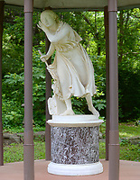 """NWA Democrat-Gazette/ANDY SHUPE<br /> The sculpture """"Nydia, The Blind Flower Girl of Pompeii"""" by Randolph Rogers stands in the backyard of Joyce and Jay Hale's Fayetteville home. The statue was purchased from the Diana Hotel in Springdale in the 1970s."""