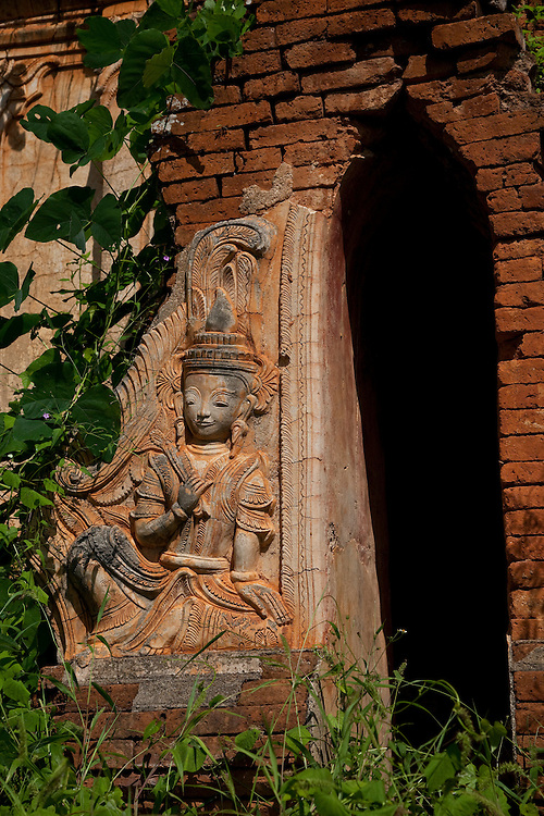 Behind Inthein village, crumbling stupas are choked in greenery-Inle Lake area,Burma