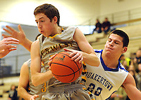 QUAKERTOWN, PA. - JANUARY 16: Central Bucks West's  Owen Cooney #22 fights for a rebound as Quakertown's Hunter Nice #22 defends in the first quarter at Quakertown High School January 16, 2015 in Quakertown, Pennsylvania. (Photo by William Thomas Cain/Cain Images)