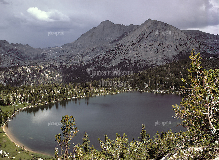 Afternoon Thunderstorms Passing. View from half way up Ragged Peak looking north across the High Sierras, Young Lakes, Yosemite National Park. View shot on Kodachrome II, Nikon Ftn camera, Nikkor 35mm f/2 lens 125th f/8, 1 August 1973