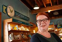 NWA Media/DAVID GOTTSCHALK - 2/26/14 - Lisa Sharp, owner of Nightbird Books in Fayetteville, stands for a portrait Wednesday Feb. 26, 2014 inside the Dickson Street location.