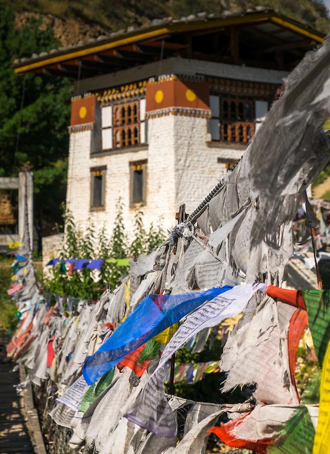 PARO, BHUTAN - CIRCA October 2014: Iron Chain Bridge and prayer flags at the Tachog Lhakhang Dzong