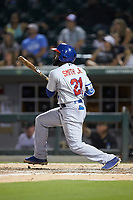 Dwight Smith Jr. (21) of the Buffalo Bison follows through on his swing against the Charlotte Knights at BB&T BallPark on August 14, 2018 in Charlotte, North Carolina. The Bison defeated the Knights 14-5.  (Brian Westerholt/Four Seam Images)